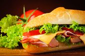 stock photo of deli  - deli sub sandwich closeup detail and ingredients - JPG
