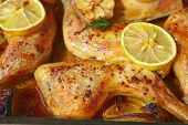 stock photo of oven  - Chicken Roasted with Lemon and Garlic just from oven - JPG