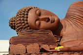 Wooden Buddha statue on Sky blue background