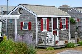 stock photo of shingles  - A traditional cottage in Cape Cod Massachusetts - JPG
