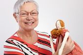 stock photo of rag-doll  - Grandmother holding rag doll - JPG