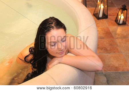 Pretty girl in the small jacuzzi