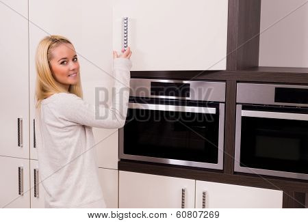 Woman in modern kitchen.