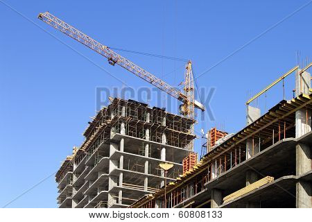 Building Cranes And Under Construction Building