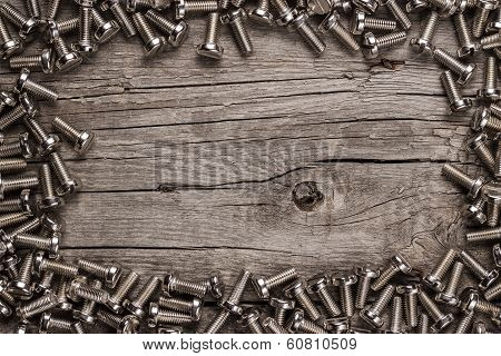 bolts on the wooden table