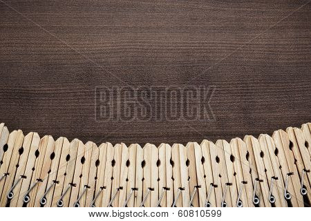 wooden clothes pegs on the table