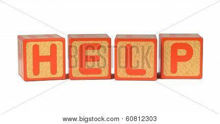 Help - Colored Childrens Alphabet Blocks.