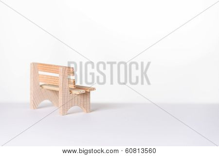 Small Simple Rustic Wooden Bench In A White Room