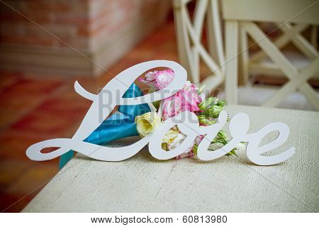 The Word Love And Wedding Bouquet