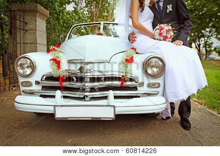 Wedding Couple With Wedding Car