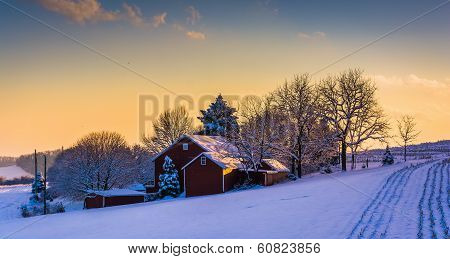 Winter View Of A Barn On A Snow Covered Farm Field At Sunset, In Rural York County, Pennsylvania.