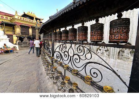 Buddhist Pilgrims Circling Around The Swayambhunath Stupa And Spinning The Prayer Wheels