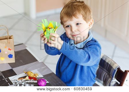 Little Toddler Boy Being Happy About Selfmade Easter Egg In Kindergarten