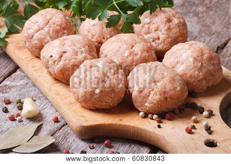Raw Meatballs On A Chopping Board And Ingredients.