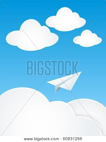 Paper Plan with clouds in sky