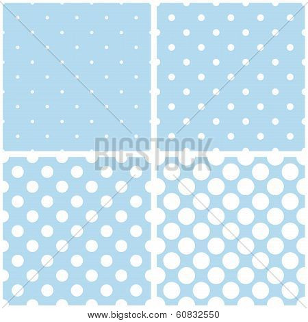 Seamless vector pattern with white polka dots on a pastel baby blue background