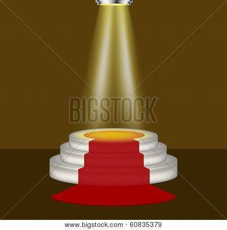 Light shines on the empty podium with red carpet