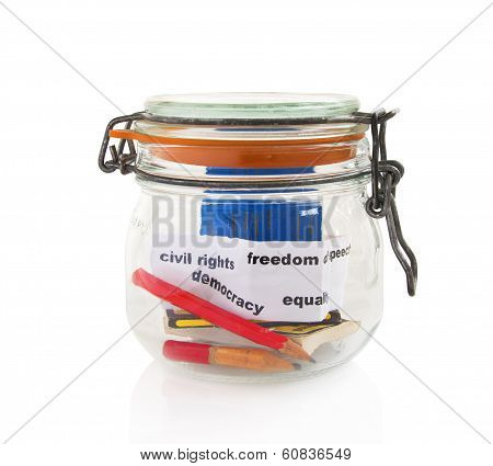 Pencils and books in glass jar