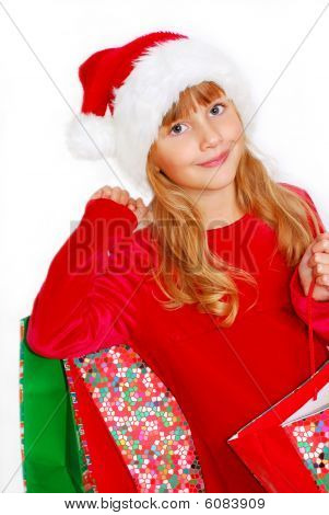 Young Girl In Santa Cloth With Gift Bags