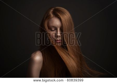 portrait of beautiful blond woman with flying hair
