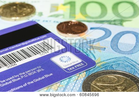 Closeup Logotype Global Blue On The Backside Of Plastic Card Against Euro Cash