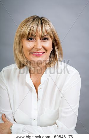 Smiling Confident Middle-aged Blond Woman