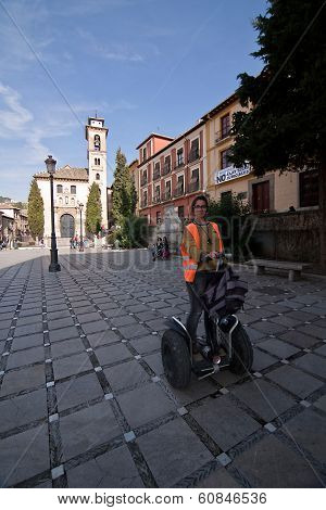 Travel agent on a segway in square of santa ana settling the Church of santa ana