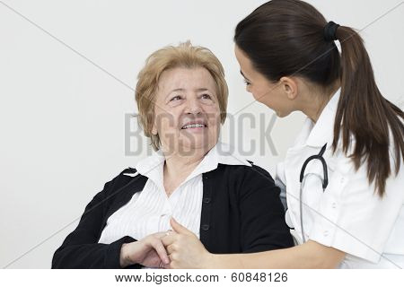 Young Nurse And Female Senior Patient