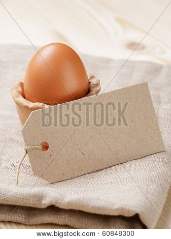 Brown Egg In Handmade Holder