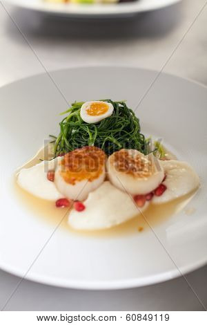 Delicious Starter Of Stuffed Savoury Eggs And Scallops