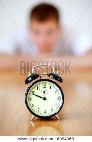 Man Staring At A Clock
