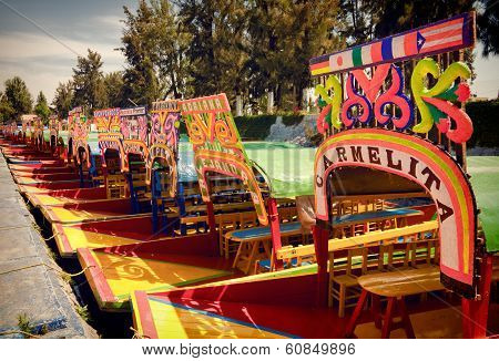 Colorful Boats Of Xochimilco Parked In A Row
