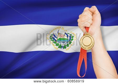 Medal In Hand With Flag On Background - Republic Of El Salvador