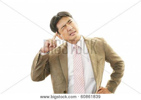 Stressed Asian businessman
