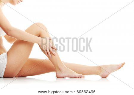 Healthy woman legs isolated on white