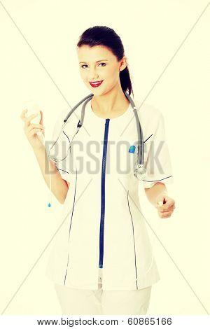 Portrait of a nurse making a drip