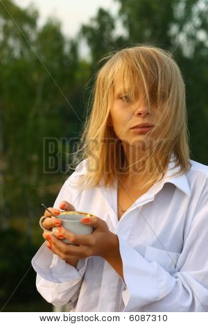 Girl drinking coffee in the morning