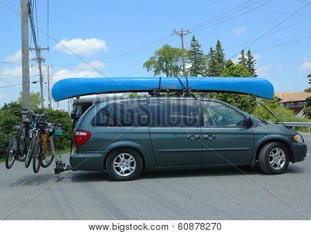 Dodge Caravan Van loaded with kayak and bicycles in Acadia National Park