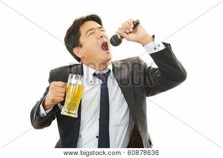 Man Singing Karaoke with Beer