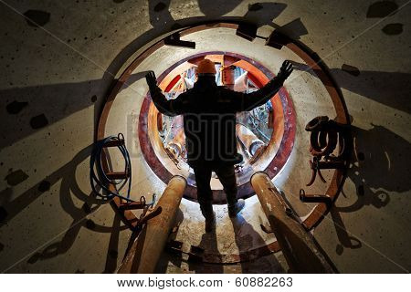 Tunneller sinker worker connecting equipment in tunnel