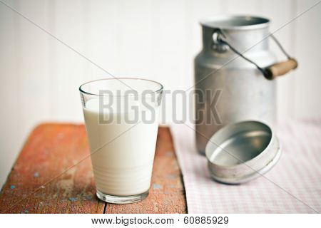 the milk in glass on old wooden table