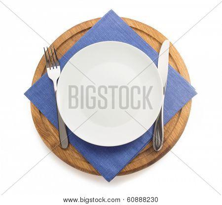 kitchen utensils at cutting board on white background