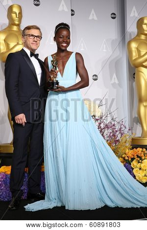 LOS ANGELES - MAR 2:  Christoph Waltz, Lupita Nyong'o at the 86th Academy Awards at Dolby Theater, Hollywood & Highland on March 2, 2014 in Los Angeles, CA