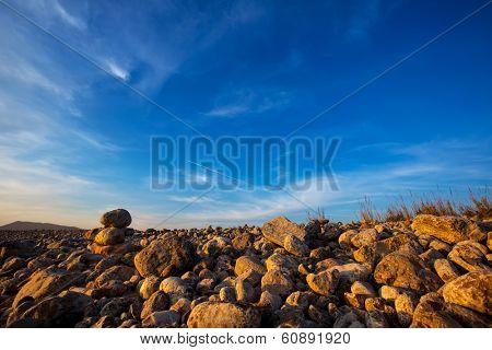 Ibiza Cap des Falco beach rolling stones in Sant Josep Balearic Islands