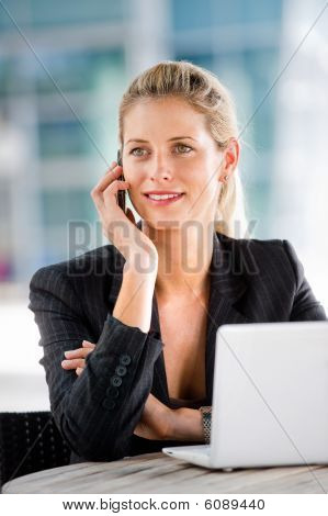 Businesswoman With Phone And Laptop