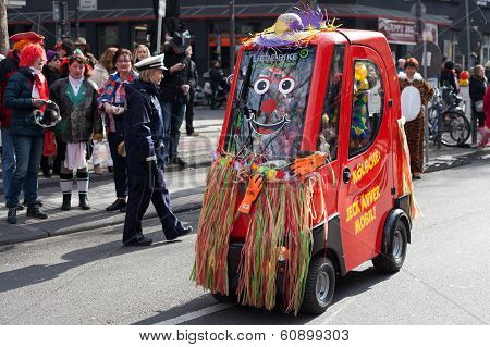 A Small Electric Car At A Carnival Procession