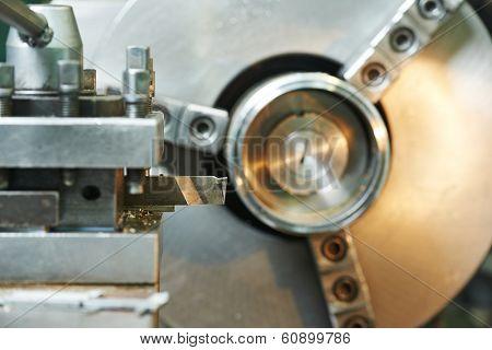 Close up industrial metal machining cutting process of metalwork