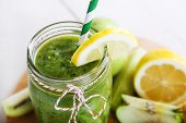 picture of cucumber  - Fresh organic green smoothie with salad apple cucumber pineapple and lemon as healthy drink - JPG