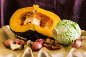 Still Life Split Pumpkin, Shallots, Garlic, Dried Chilli And Cabbage