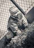 image of creeping  - black and white retro style photo of baby creeping outdoor